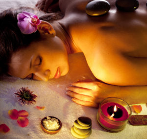 Young woman getting stones spa procedures.